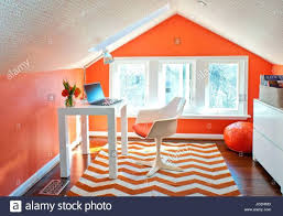 home office rug placement. Various Attic Home Office Orange Walls Wallpaper On Ceiling Shite Herringbone Area Rug Modern Chair Placement A