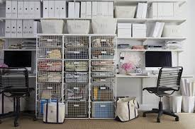 modular desk and under shelves with white metal storage bins