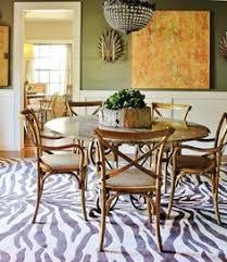dining room with zebra print rug