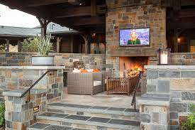 country flagstone patio with stone fireplace tv niche