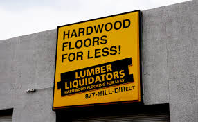 A Sign Outside A Lumber Liquidators Store In Denver.