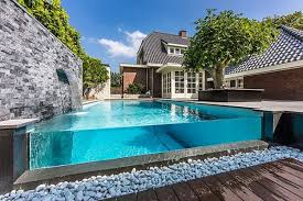 Delightful Coral Stones Around Feat Wood Flooring Also Modern Outdoor  Rectangular Pool As Backyard Contemporary House Designs