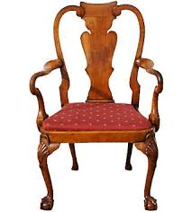 A walnut Queen Anne chair with a drop in seat urn shaped solid