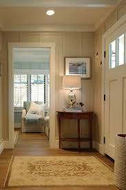 white foyer table. Minimalist White Foyer Designed With Corner Wooden Side Table Plus Decorative Lamp Near Doorway Idea R