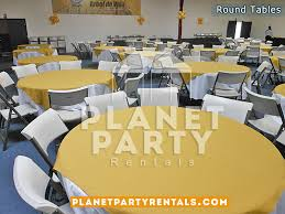 60 round plastic table with white tablecloths and yellow overlay with white chairs