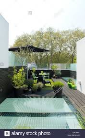 rooftop furniture. Outdoor Furniture And Potted Plants On Modern Roof Terrace Stock Rooftop