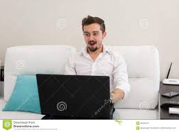 handsome businessman working with laptop in office happy young man in