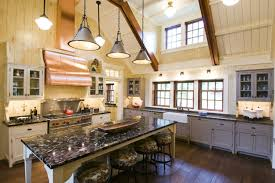 kitchen with ceiling beams and a copper hood