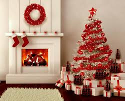 This living room featuring red christmas decorations is truly breathtaking.  The shade of red against white gift boxes, walls and Christmas tree is  truly ...