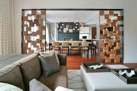 unique room divider using wooden boxes separates the living and dining spaces design betty