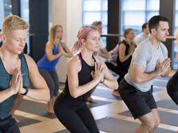 people in a yoga cl
