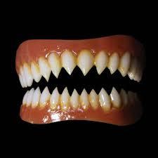 sharp teeth. gremlin pointed teeth sharp e
