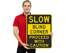 blind curve and blind corner signs