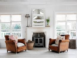 pair of weathered leather armchairs make all the difference in this living room design chic living room leather