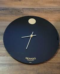 movado wall clock in black off 70