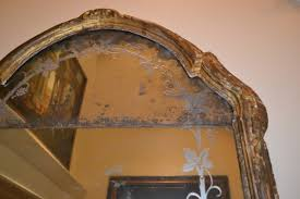 this early 18th century pier mirror is a rococo design with leae and shell work the graceful arched cresting sits on two original glass mirrors