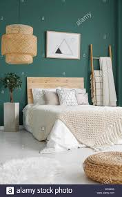 emerald green bedroom. Brilliant Green Pouf And White Fur On The Floor Near Bed With Knit Blanket In Emerald Green  Bedroom Interior Plant Poster Intended Emerald Green Bedroom R
