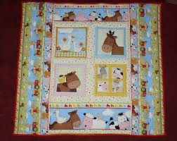 Crafty Ady: A quilted playmat for baby Jacob & It's made from a printed fabric panel of farm yard animals with  co-ordinating border stripes on each side of the panel. This is the Home  Farm fabric from ... Adamdwight.com
