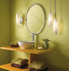 lighting in the bathroom. modern bathroom vanity lights for minimalist which is using round mirror above wooden and porcelain sink under the metal faucet lighting in