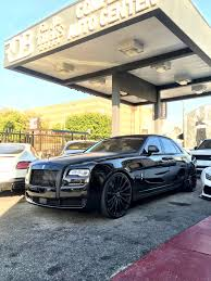 rolls royce ghost white with black rims. rolls royce ghost white with black rims
