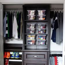 a closet organizer system installed in a boy s bedroom closet