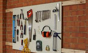 Place and mark the tools to the pegboard