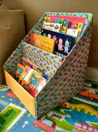 i had converted a little wooden side table as his reading corner and had stacked up his books into that one shelf it was neatly arranged and easy for him