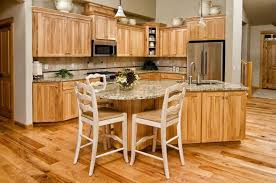 points of interest yellow pine floors custom beige granite island countertop with integrated round table style seating natural hickory cabinets