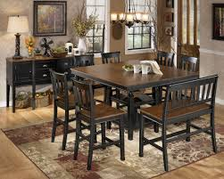 extendable dining room table by signature design by ashley. transform dining room ashley furniture about owingsville square counter height extendable set from table by signature design