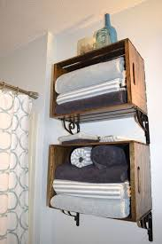 pallet box shelving units with towels next to the shower zone is a timeless solution