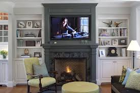 stackable stone fireplace with built ins on each side for traditional family room and wood molding