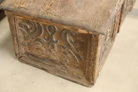 this is a very early hand carved trunk from spain with hints of painted patina