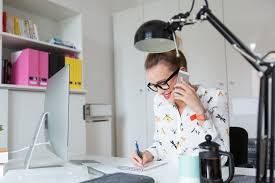 Home office lighting Pendant Woman Working In An Office Talking On Phone The Spruce How To Create Better Home Office Lighting