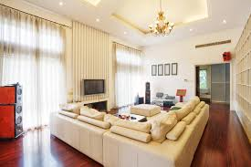 Contemporary living room couches Affordable Cherry Wood Flooring Supports Large Beige Leather Living Room Sectional Sofa In This High Ceiling Space Home Stratosphere 45 Contemporary Living Rooms With Sectional Sofas pictures