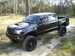 Double cab and lifted Toyota Tacoma murdered out with black wheels ...