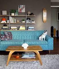 taupe gray wall and teal sofa home