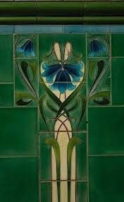 the cool blue green flow of the feminine captured in art nouveau tile mosaic