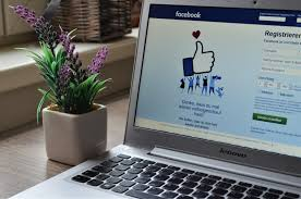 picture of laptop open, with the homepage of facebook