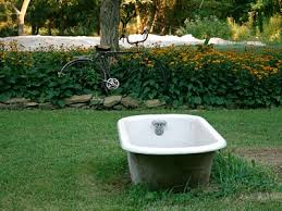garden decorations. This Garden Is Adorned With A Bicycle And Bathtub -- Not Something You See Decorations S