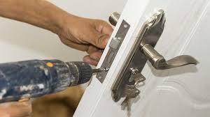person installing a door lock