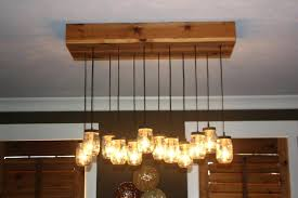 mason jar light fixture chandeliers mason jar lighting fixtures and chandeliers with cedar bases wooden panel