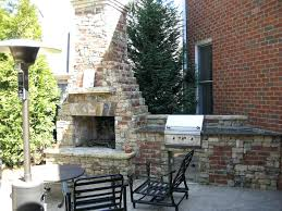 fireplace and grill stacked stone and brick fireplace and grill fireplace cooking grate