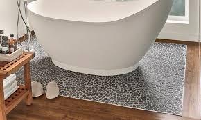 marble pebbles under tub