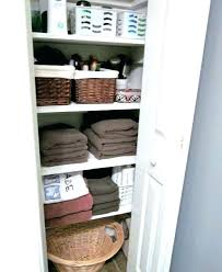 bathroom closet organization ideas how to organize deep narrow linen shelf spacing storage s