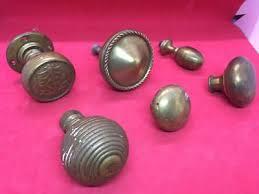 interesting lot of vintage reclaimed brass door handle knobs