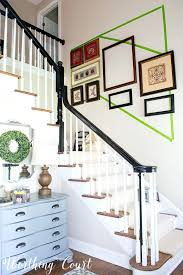 stairway photo gallery using old frames to figure the layout for a stairway gallery wall court stairway photo gallery gallery wall