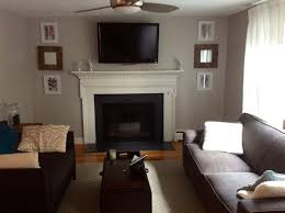 painted brick fireplace with black brick stone fireplace and white storage also black tv