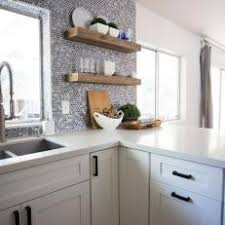 Gray and Black Penny Tile Backsplash Accent Wall With Floating Natural Wood  Shelves