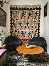 vintage rug hanging on the wall