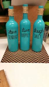 Wine bottles I painted with spray paint and Used My Cricut for the letters.  Spray